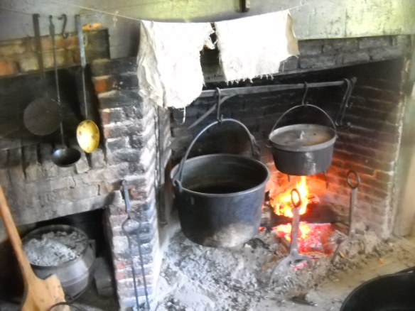 Typical period kitchen. Fireplace is always going. Wicked hot in there!