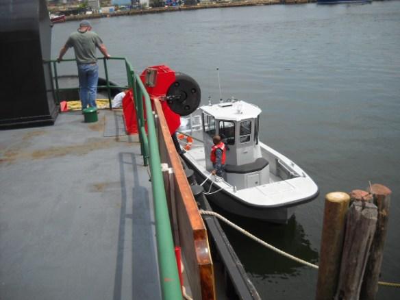 Navy pilothouse skiff.