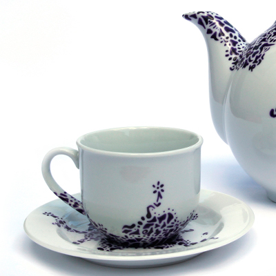 Detail of hand painted tableware made by Veerle Ritstier with purple coloured particles.