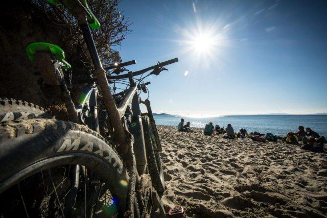 Cycling in the winter mountain bike women are resting Silla beach of Calaviolina
