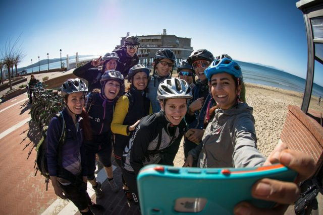 Girls while making a selfie on the beach of Follonica
