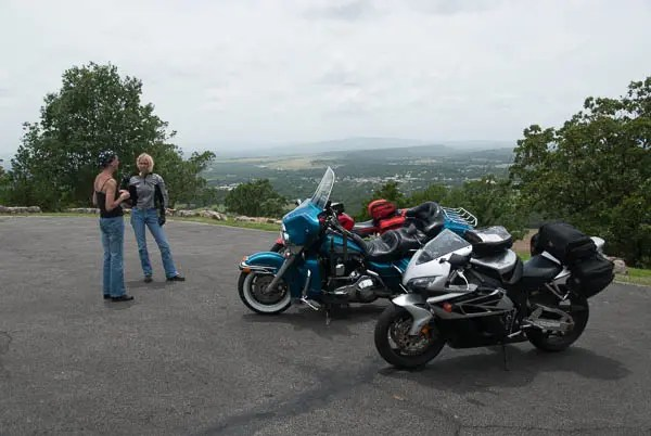 Kay Pratt and Patty Youngpeter stop to talk in front of their bikes at Heavener Runestone Park