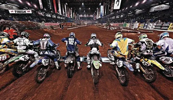 Endurocross riders line up at the start of the race at Lazy E Arena in Guthrie.