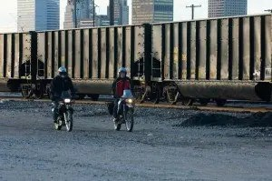 Phil Templeton and David Jungroth ride south of downtown OKC along the train tracks.