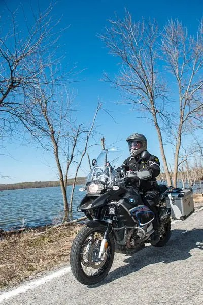 Bill Dragoo riding his BMW GS along the shores of Fort Gibson Lake.
