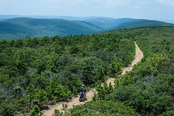 The K-Trail winds across the spine of the Ouachita Mountains from Clayton, OK to Mena, AR. Many dual sport riders call it the dirt version of the Talimena Drive. While most of the trail is fairly easy, some parts are quite a challenge on anything bigger than a dirt bike.
