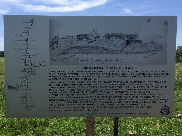 A detailed marker with information about the site.