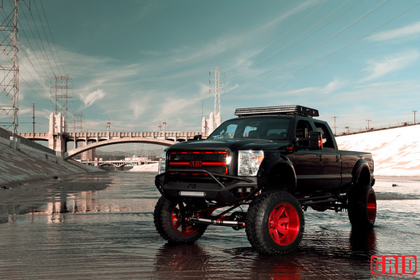 grid-offroad-gf1-brushed-red-ford-f350-super-duty-toyo-tires-bulletproof-suspensions-atlas-springs-fab-fours-anzo-performance-lighting-5-600x400