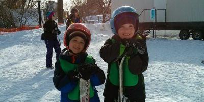 Carter and Colton suffer a ski lesson.