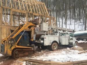 bucket truck and skid steer on Ridge Haven Homestead
