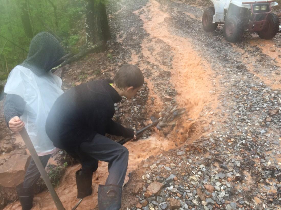Digging out driveway in rain at ridge Haven