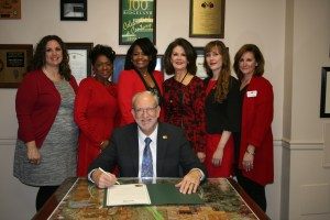 From left, are Katherine Bryant, Rochelle Culp, Rhonda Lampkin, Jan Collins, Christy Bridges, and Jill Strickland surround Mayor Gene McGee as he signs Proclamation for Wear Red Day. Mayor McGee also signed a Proclamation for American Heart Month. Both proclamations help educate and increase awareness about heart disease and stroke, encourage citizens to learn the warning signs of heart attack and stroke, and to seek to prevent cardiac events through healthy living. National Wear Red Day is Friday, Feb. 5. Citizens are asked to show their support for women and fight against heart disease by commemorating this day by wearing the color red.