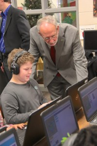 Mayor Gene McGee looks on as one of Highland Elementary's Pathways students participates in Hour of Code this week.