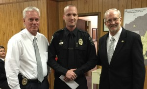 "Officer Ryan Jungers was selected as Ridgeland Police Officer of the Month for December, 2015. Police Chief Neal said, ""Officer Jungers' actions resulted in the quick apprehension of suspects and exhibited the initiative of a great officer."" Jungers, center, is pictured with Chief John Neal (left) and Mayor Gene McGee (right)."