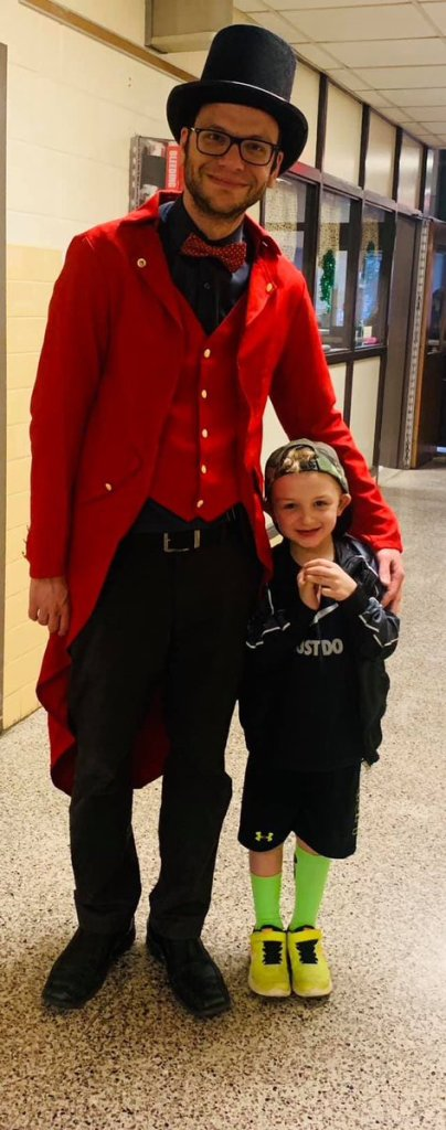 Assistant Principal Mr. Angeloni dressed in carnival gear with a student
