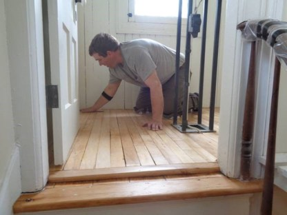 May 7 – Taylor buffing floor in lantern room prior to third and final finish coat
