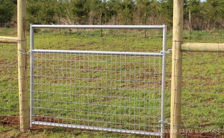 Ridgetop Farm and Garden   Instaling our Goat Fence