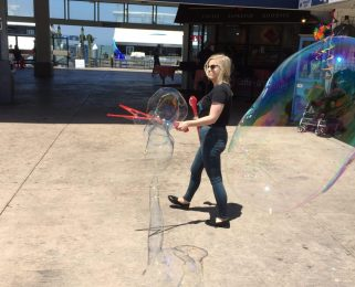 On Pier 41 waiting for ferry - blowing huge bubbles is fun