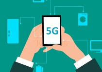 conceptual image of 5G superfast broadband, hands of cartoon man in suit holding mobile phone