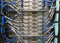 wires and cables sticking out from a server rack in a data centre