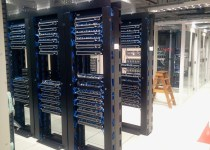 data centre server room with rows of tower-style server racks