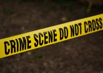 Crime scene do not cross banner black text yellow background