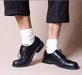 White socks with black shoes is a style faux pas