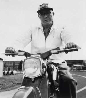 Soichiro Honda Riding the Honda Dream C70