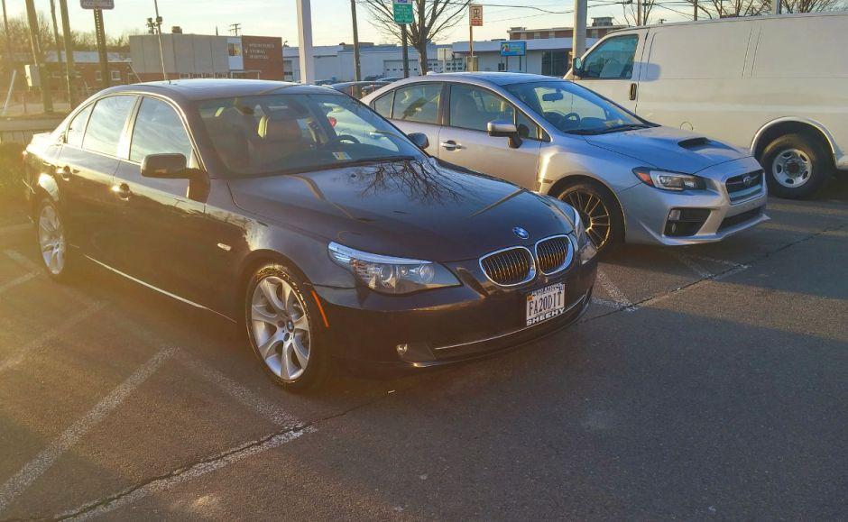 BMW 535i and Subaru WRX at Dealership