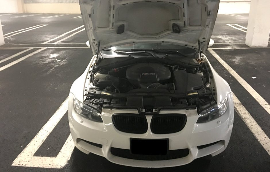Hood open on 2008 BMW M3 showing the S65 V8 engine