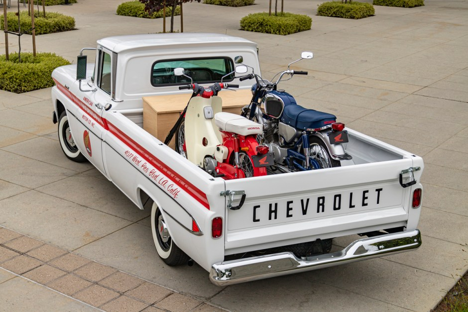 Chevy delivery pickup truck with Honda motorcycles in bed