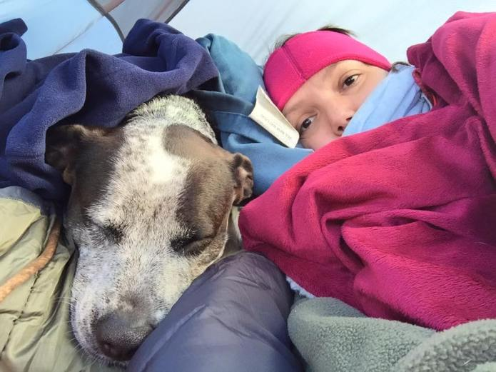 Caddie and me snuggling in the tent.