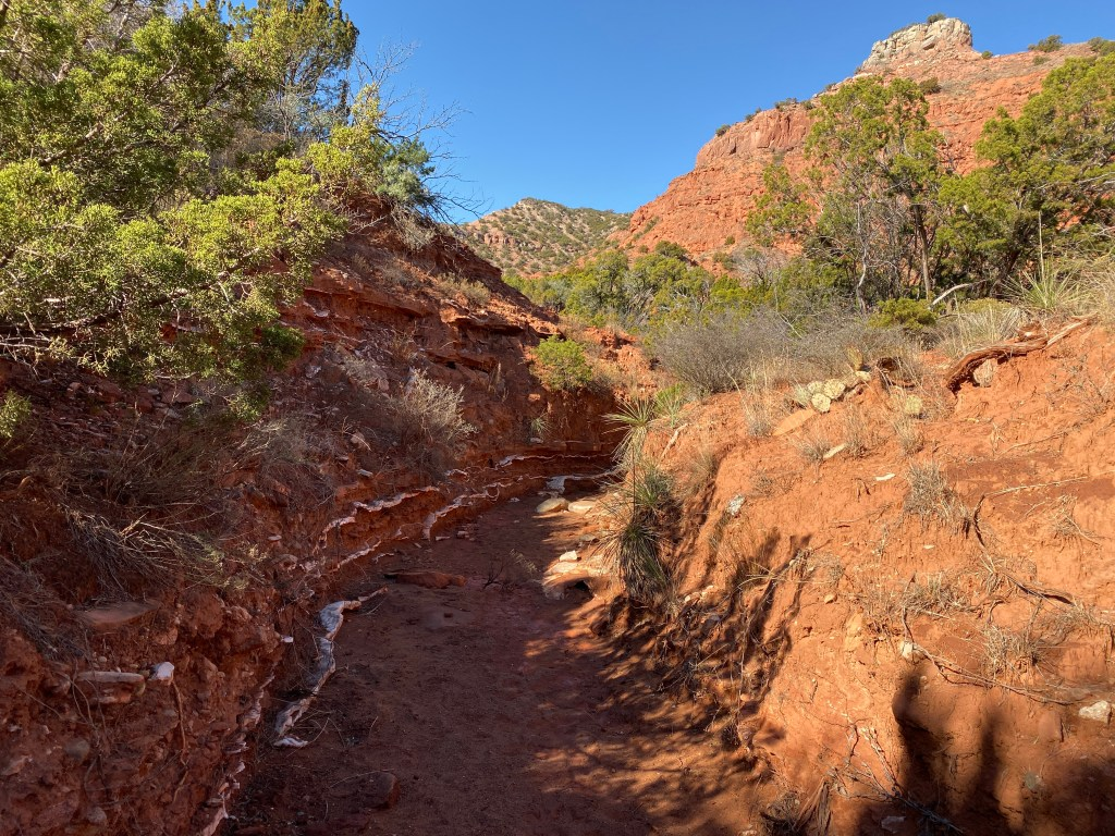 layers of rock are shown in a wash at Caprock Canyons State Park