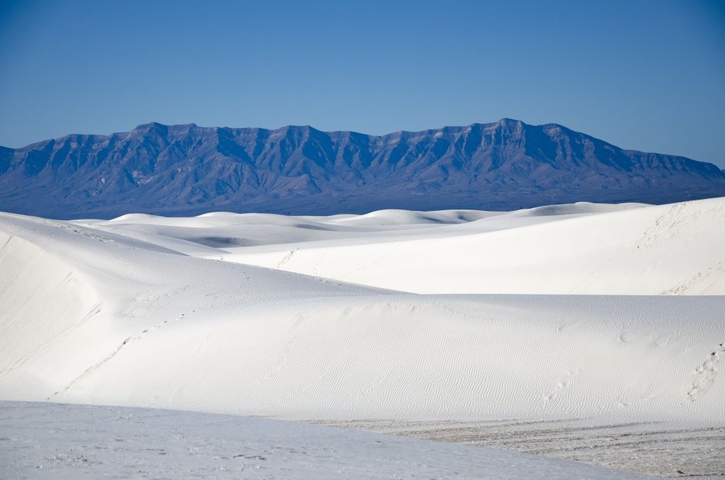 a sea of white sand is shown
