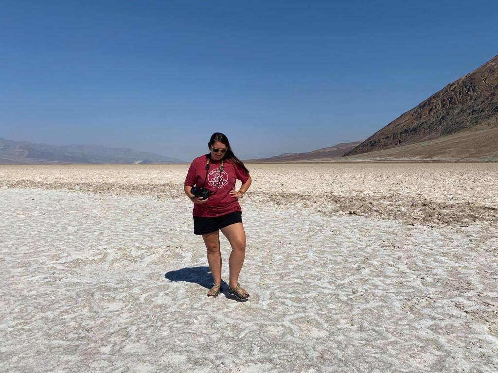 a woman walks in badwater basin