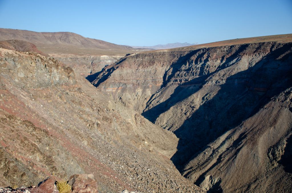 black lava is shown in Death Valley National Park in the summer