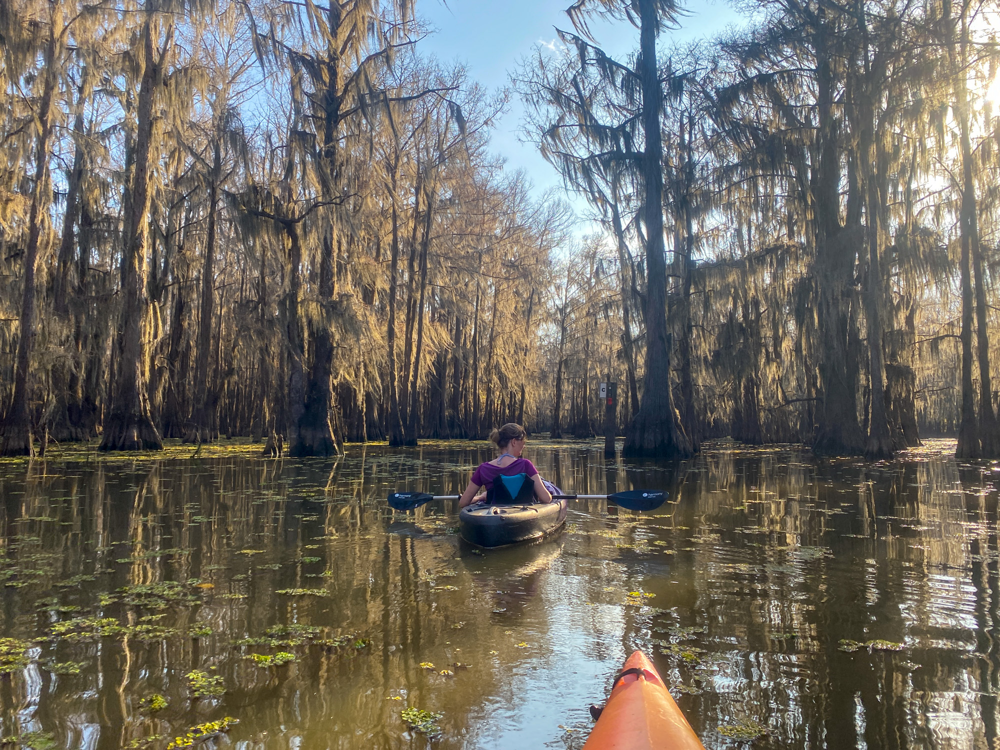 A woman kayaks on Hell's Half Acre Paddling Trail