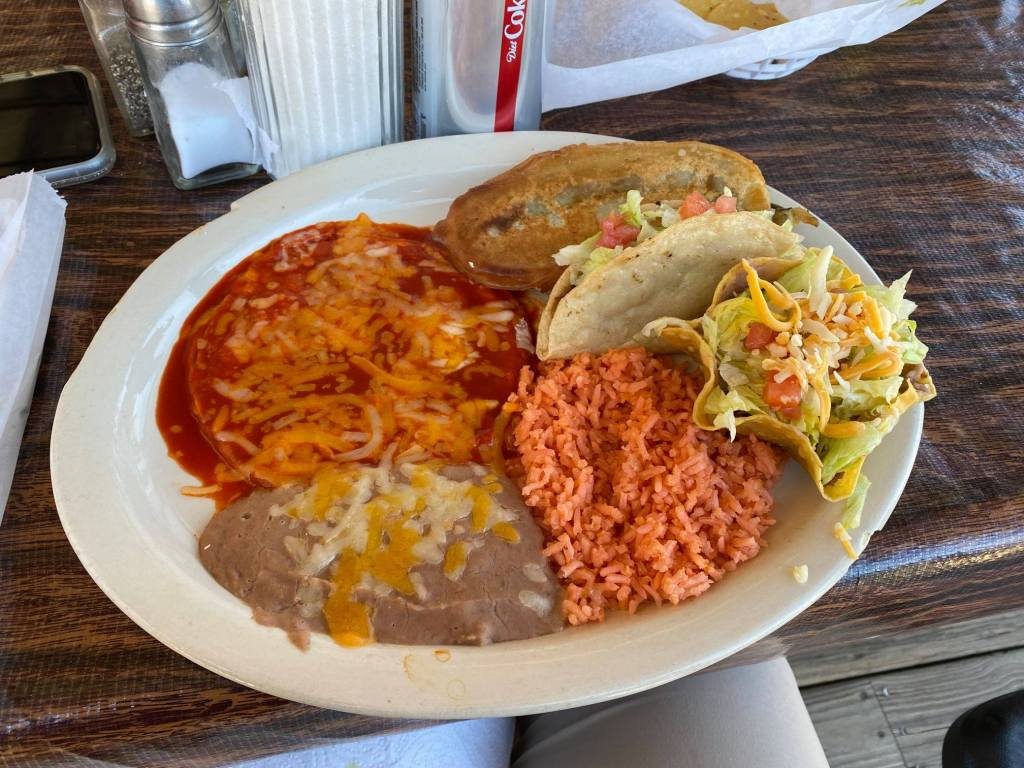 A plate of Mexican food is shown