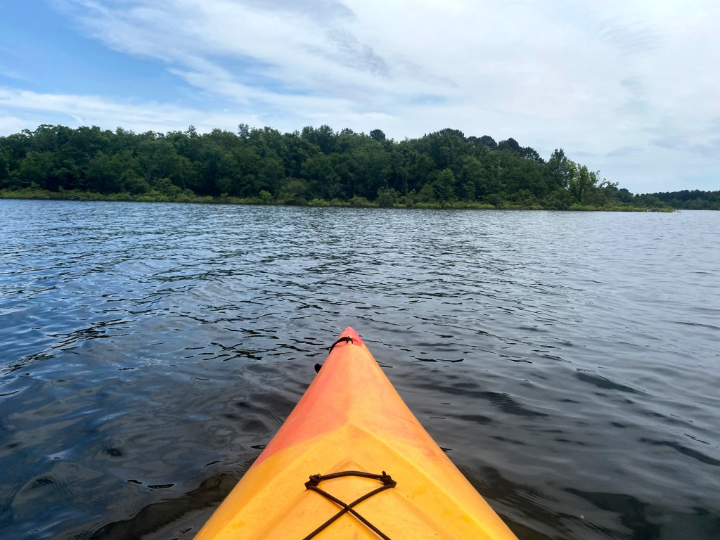 A kayak is shown on th Islets Cove Paddle Trail