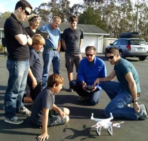 Brandon Lima, Rigneys, and Harrises get quadcopter flying lesson from Phillip Lima (photo Paulette Lima)