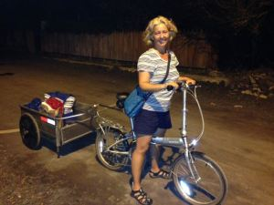 Leslie uses bike cart to do late night provisioning. (photo by Bill Kohut)