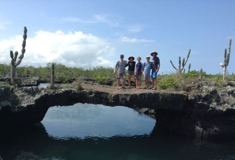 One of many natural lava bridges over an aquarium of clear water