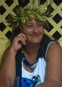 Chantale Falchetto wearing a handmade crown of leaves. It is a tradition for women to make and to wear crowns during celebrations.