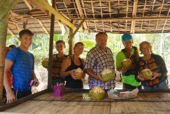 Bryce Rigney, Trent Rigney, Natalia Ptasinska, Wojciech Maleika, Eric & Leslie Rigney taking a coconut break during river rafting.