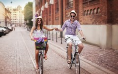 People-Happy-Couple-Biking-in-the-City-during-Summer-Medium-thegreentribe