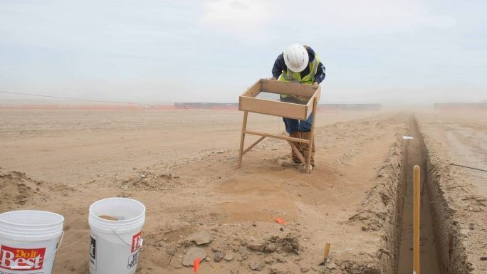 Person in the desert with safety gear on.