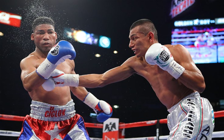 Robinson Castellanos (right) punches Yuriorkis Gamboa during their WBA elimination bout in May 2017. (Photo by Tom Hogan / Hoganphotos-Golden Boy Promotions)