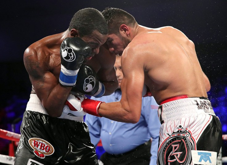 Gilberto Ramirez (right) and Jesse Hart go at it during their dramatic WBO super middleweight title bout. Photo / @TRboxing