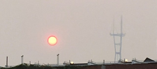 Smoke-diffused sun and Sutro Tower