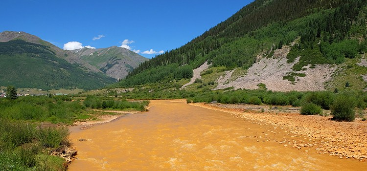 Photo of the polluted Animas River after the Gold King Mine incident, for the Rio Grande Sierra Club Chapter website